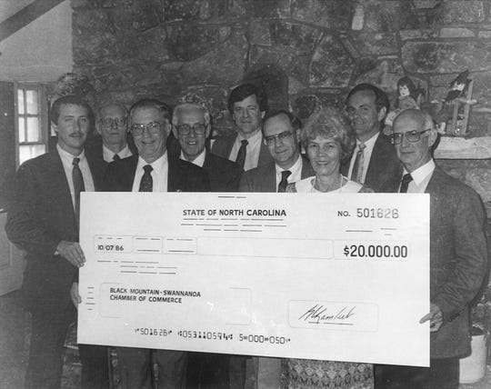 Andy Andrews, far right, is presented with a check from the State of North Carolina in 1986 to help complete renovations to the former McGraw Coffee House building.