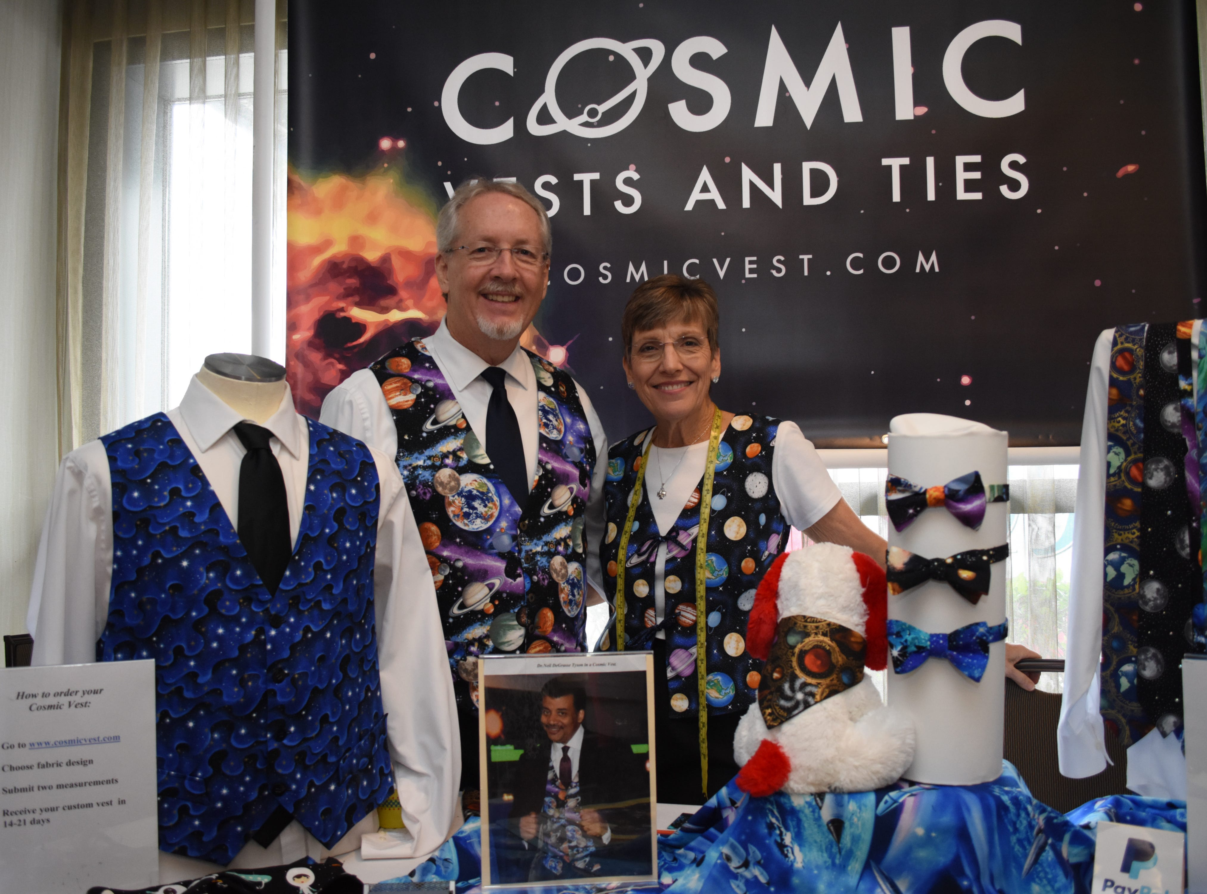 Mary and Patrick McCarthy with Cosmic Vests and Ties pose for a photo.