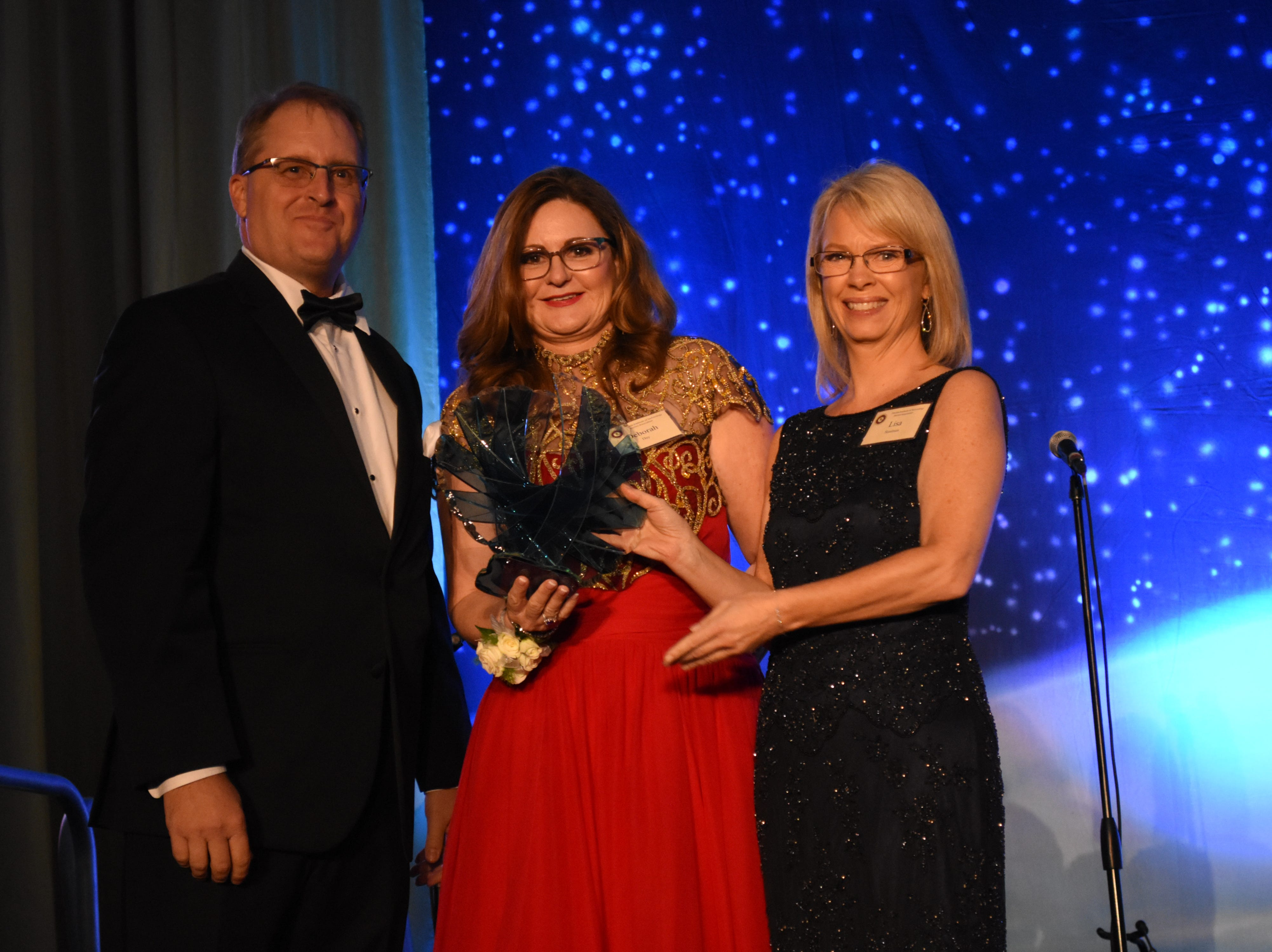 The College of Psychology and Liberal Arts Outstanding Alumni award is presented to Deborah O. Day at Florida Tech's 60th Anniversary Homecoming Gala Oct. 13, 2018, at the Clemente Center.