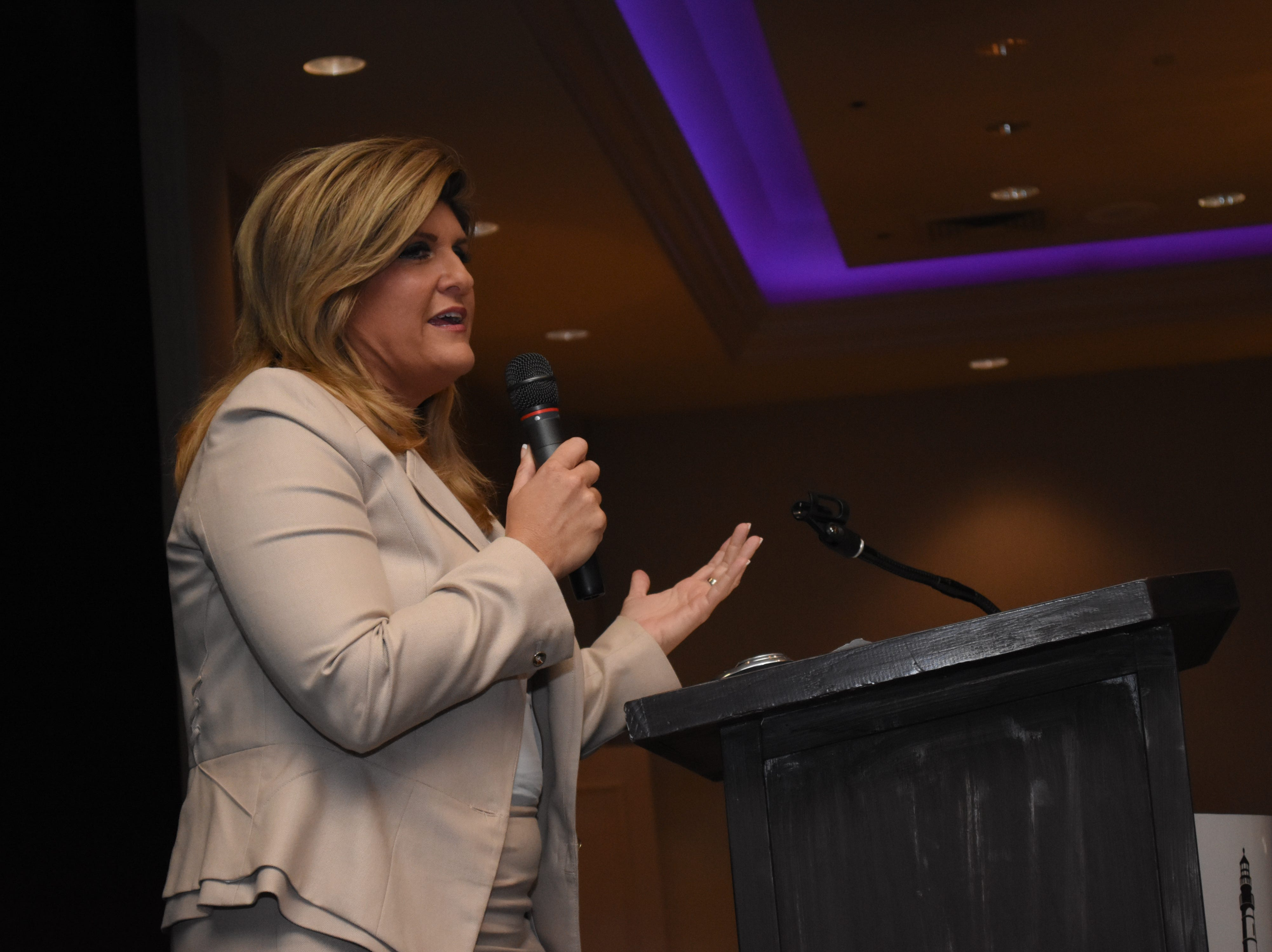 Former mayor of Cape Coral Marni Sawicki speaks about domestic violence to the crowd.
