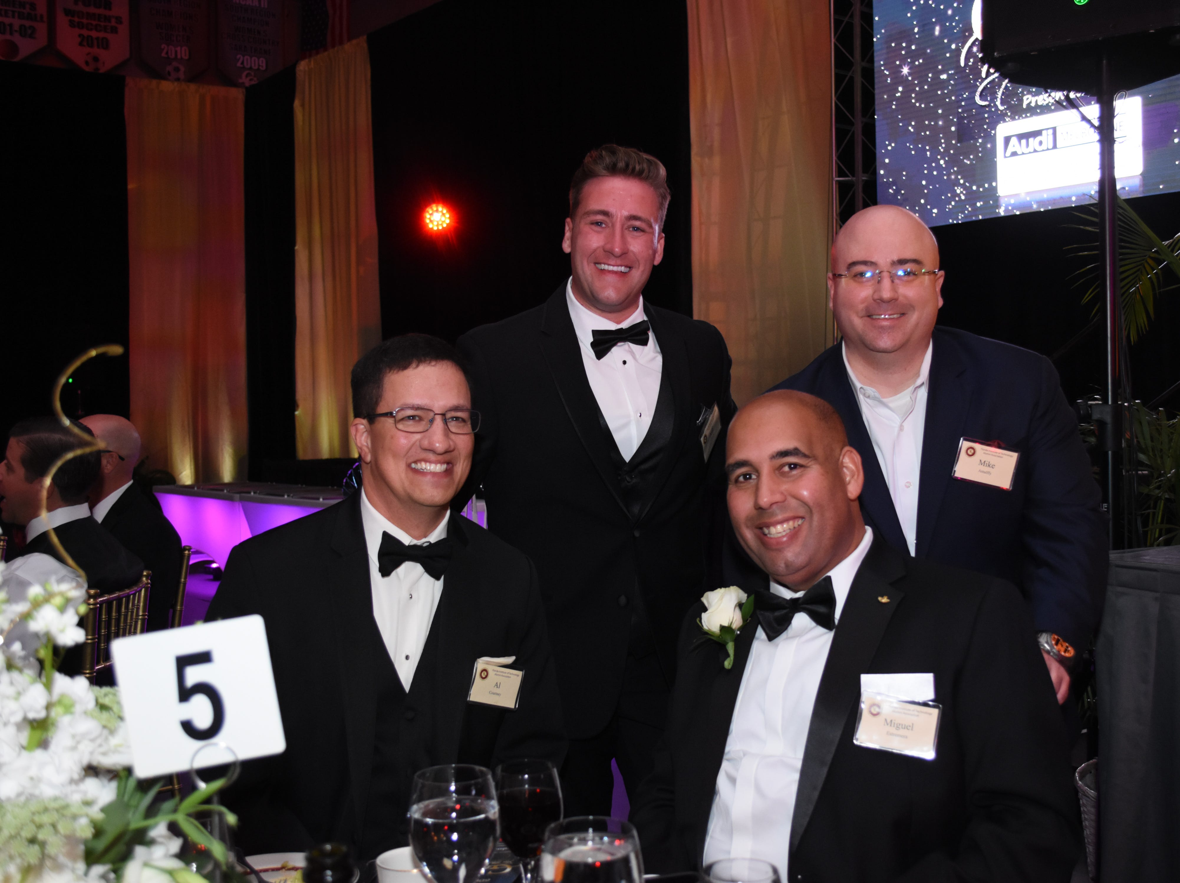 Mike Antalffy, Skurla Award recipient Miguel Estrenera, Al Courtney and Jeff Ciarcia at Florida Tech's 60th Anniversary Homecoming Gala Oct. 13, 2018, at the Clemente Center.