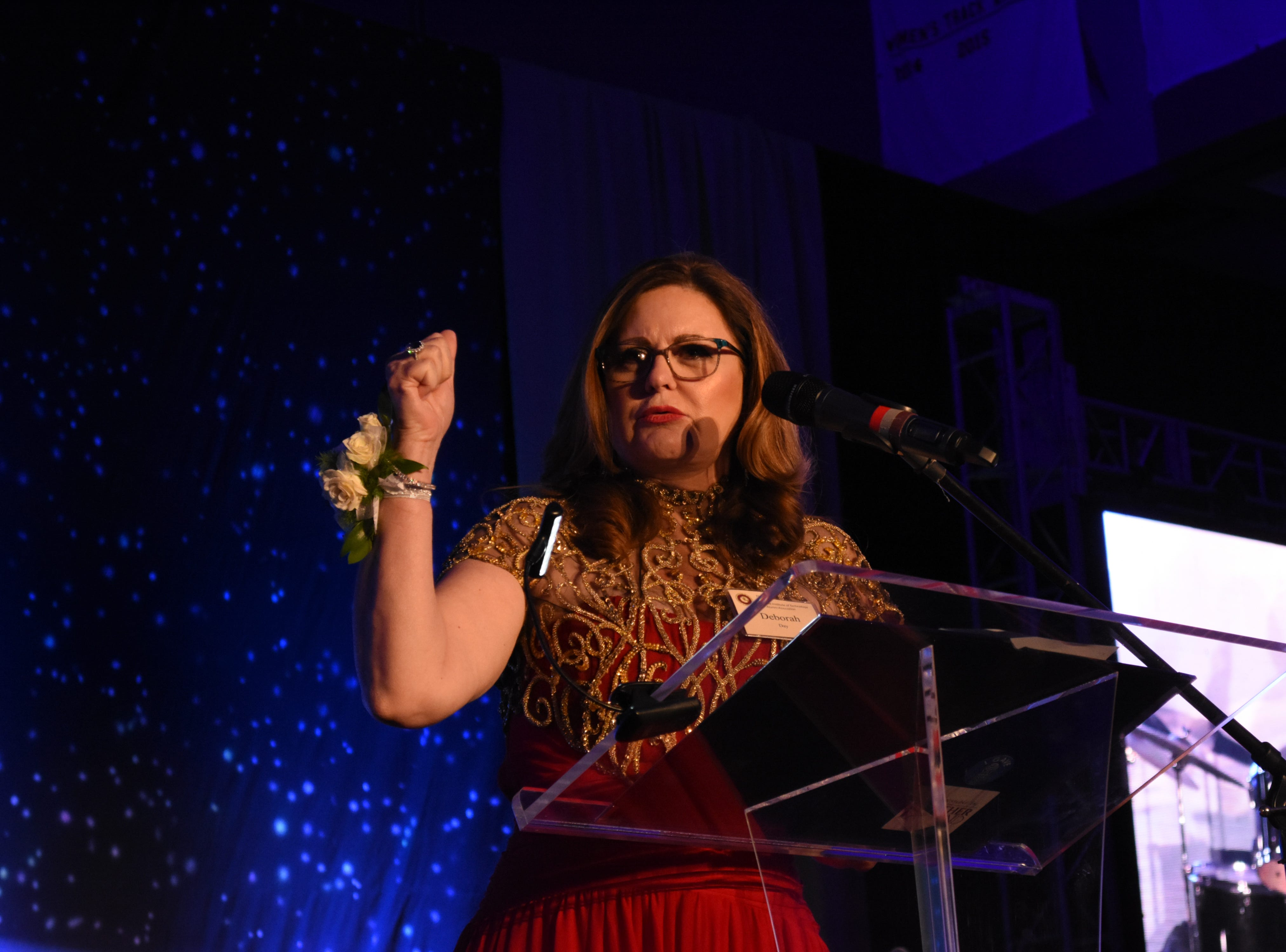 The College of Psychology and Liberal Arts Outstanding Alumni award winner Deborah O. Day speaks to the crow at Florida Tech's 60th Anniversary Homecoming Gala Oct. 13, 2018, at the Clemente Center.