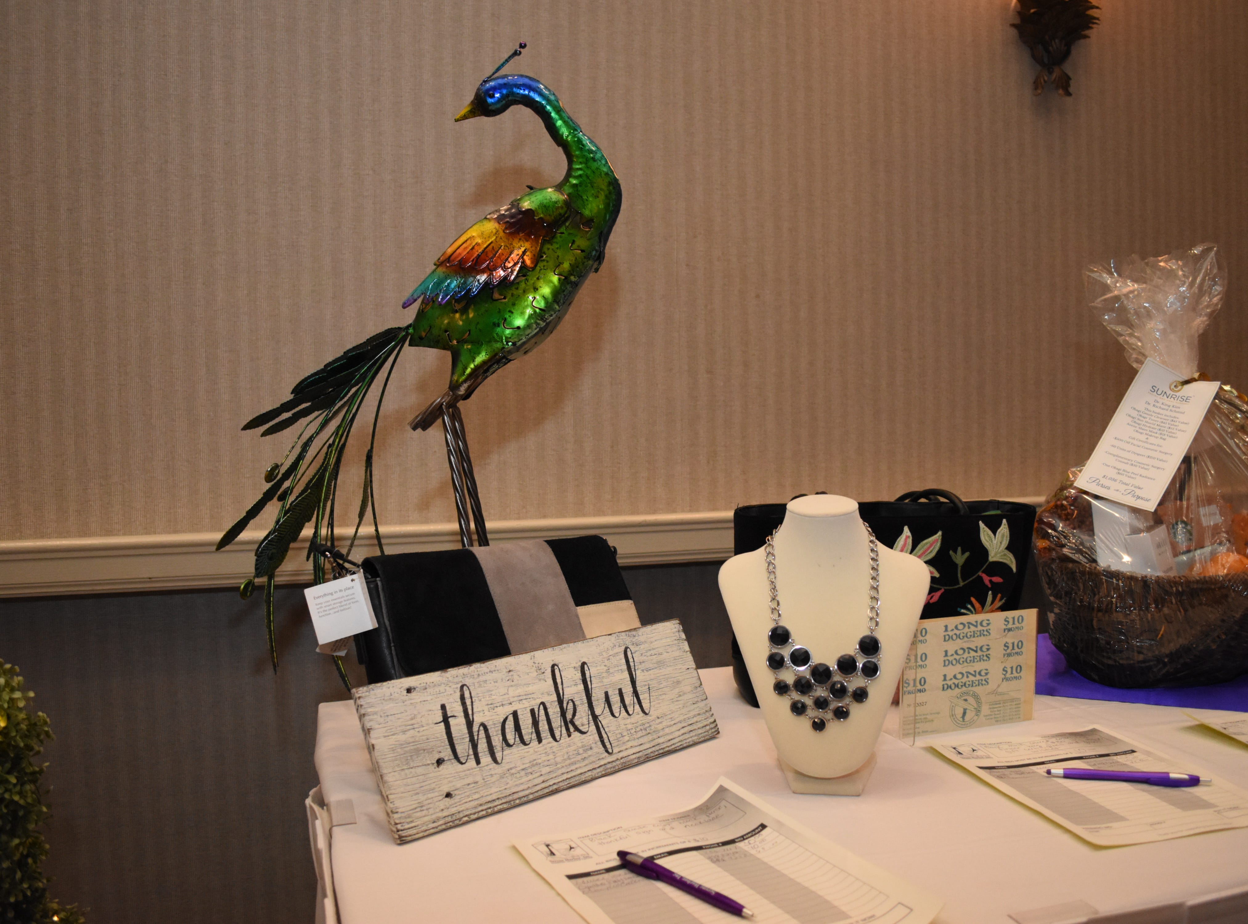 Silent auction items at the 2018 Purses with a Purpose fundraiser in Melbourne.