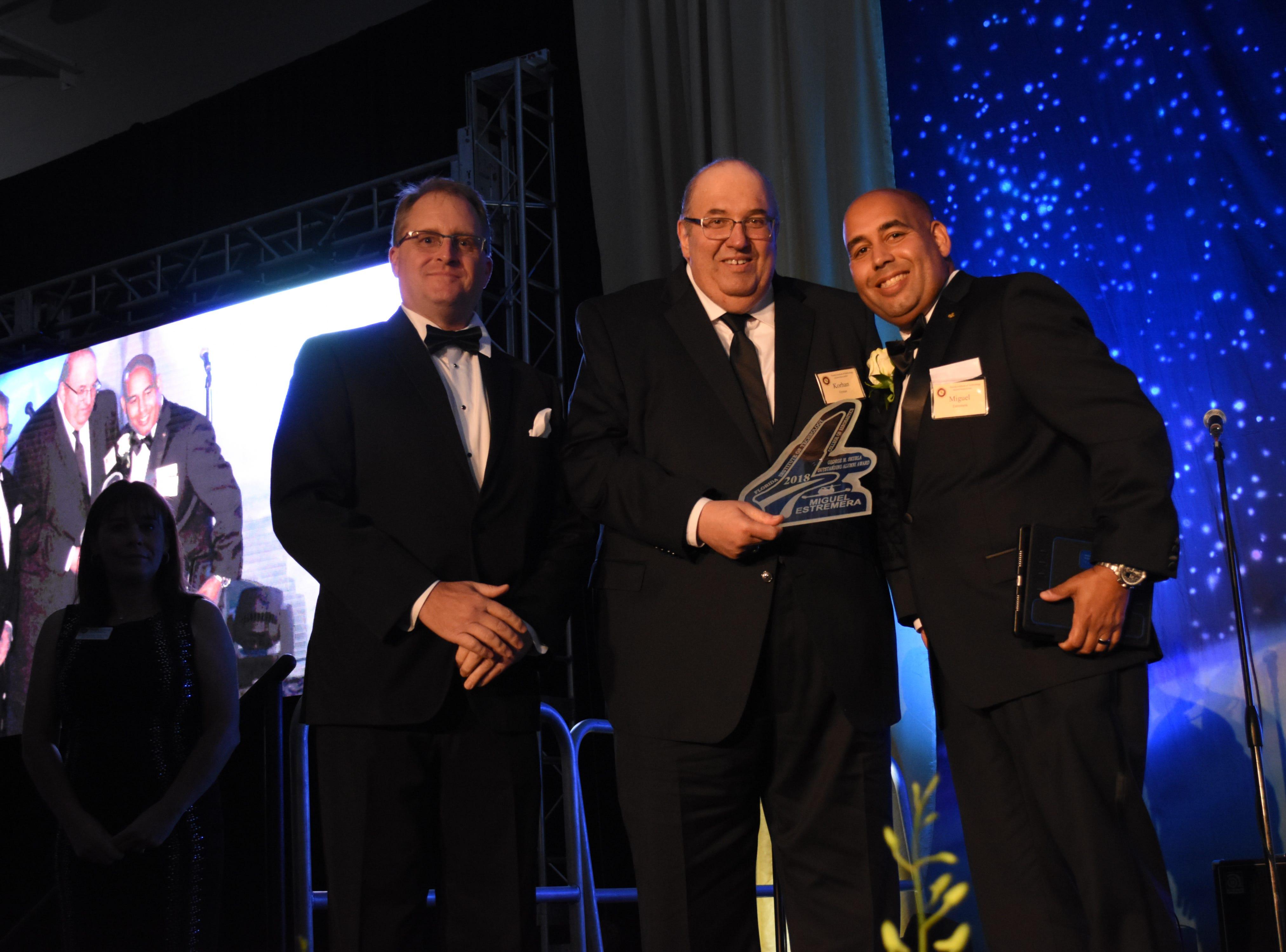 Florida Tech aeronautics dean Korhan Oyman presents Miguel Estremera the Skurla award at Florida Tech's 60th Anniversary Homecoming Gala Oct. 13, 2018, at the Clemente Center.