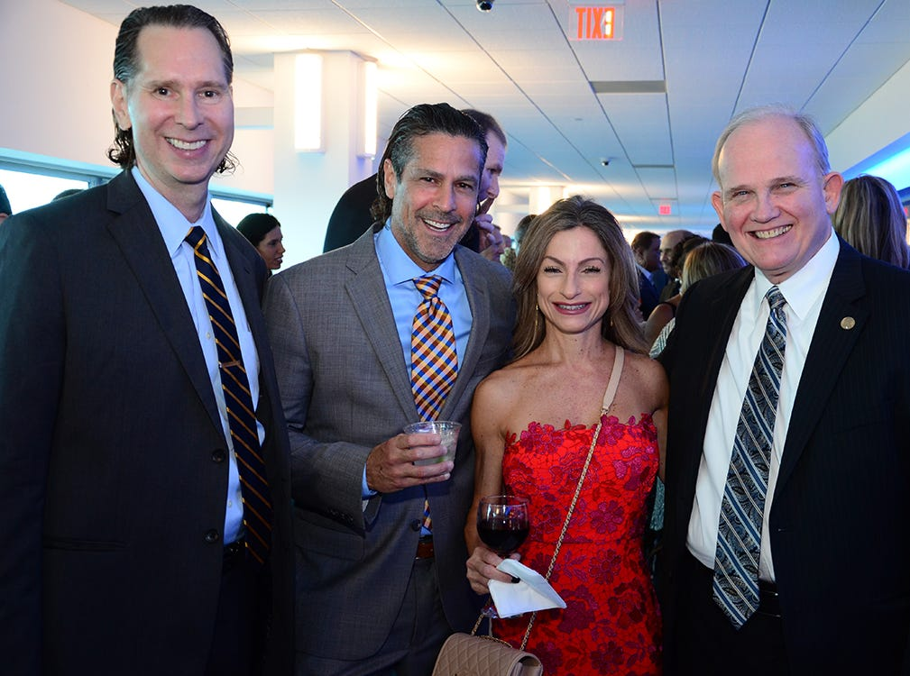 Paul Quinn, Charlie and Heather Ramos, along with Bill Boyles  pose for the camera Saturday evening at Port Canaveral during the Fly Me to The Moon gala to benefit the Jess Parrish Foundation.