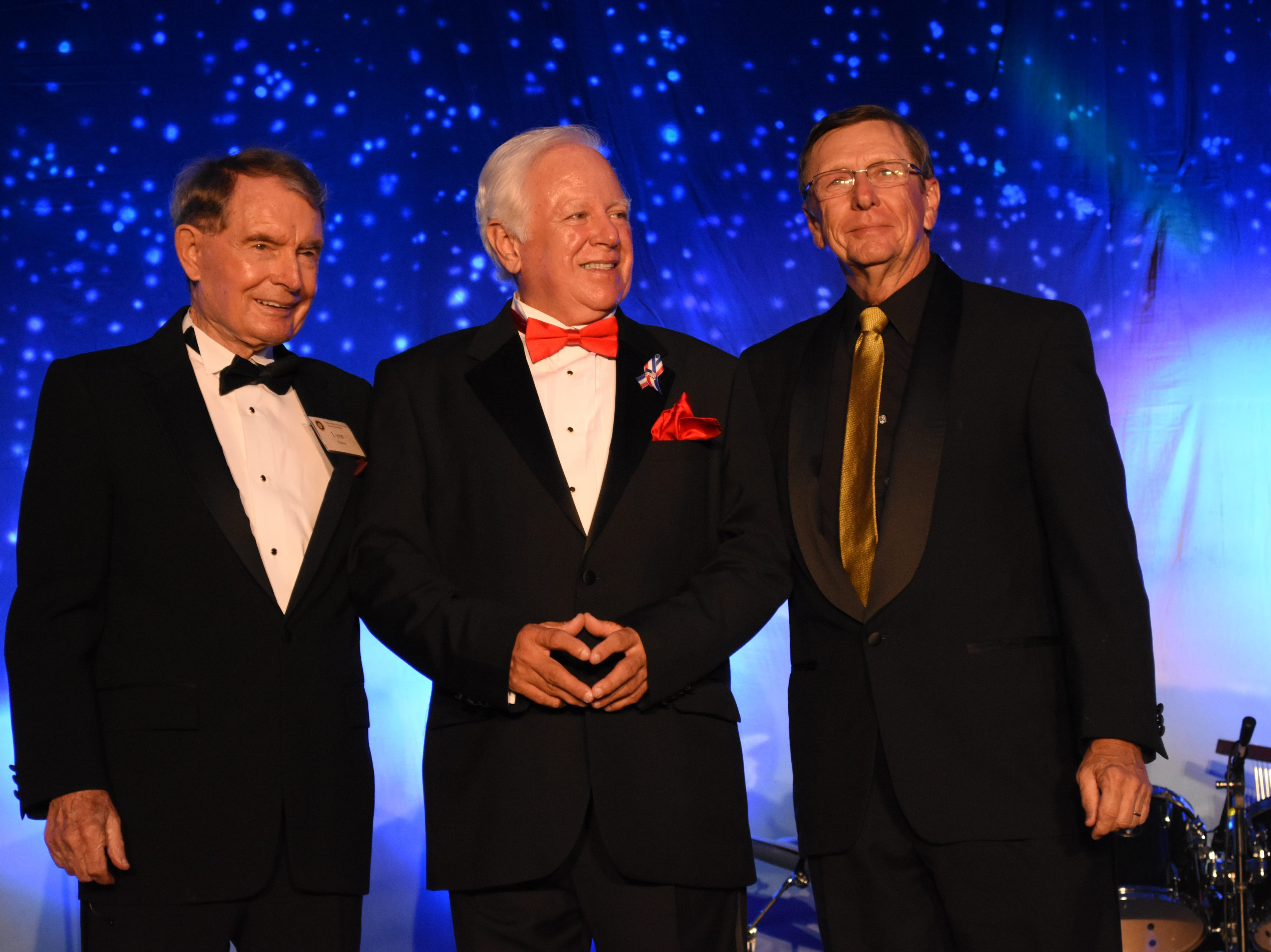 Florida Tech's third president, Dr. Lynn E. Weaver; fourth president, Dr. Anthony J. Catanese; and fifth and current president, Dr. T. Dwayne McCay, stand together at Florida Tech's 60th Anniversary Homecoming Gala Oct. 13, 2018, at the Clemente Center.