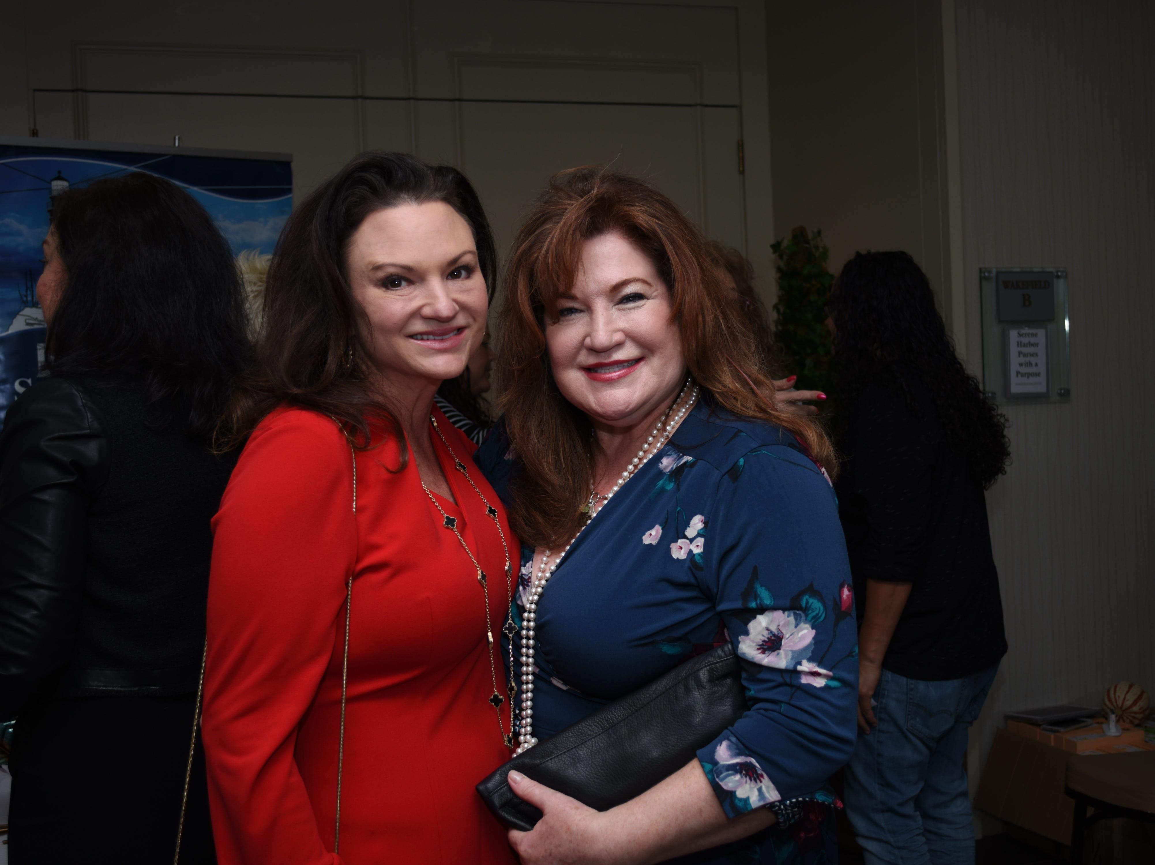 Sheri Tremmel and Ruthi Menendez pose for a photo.