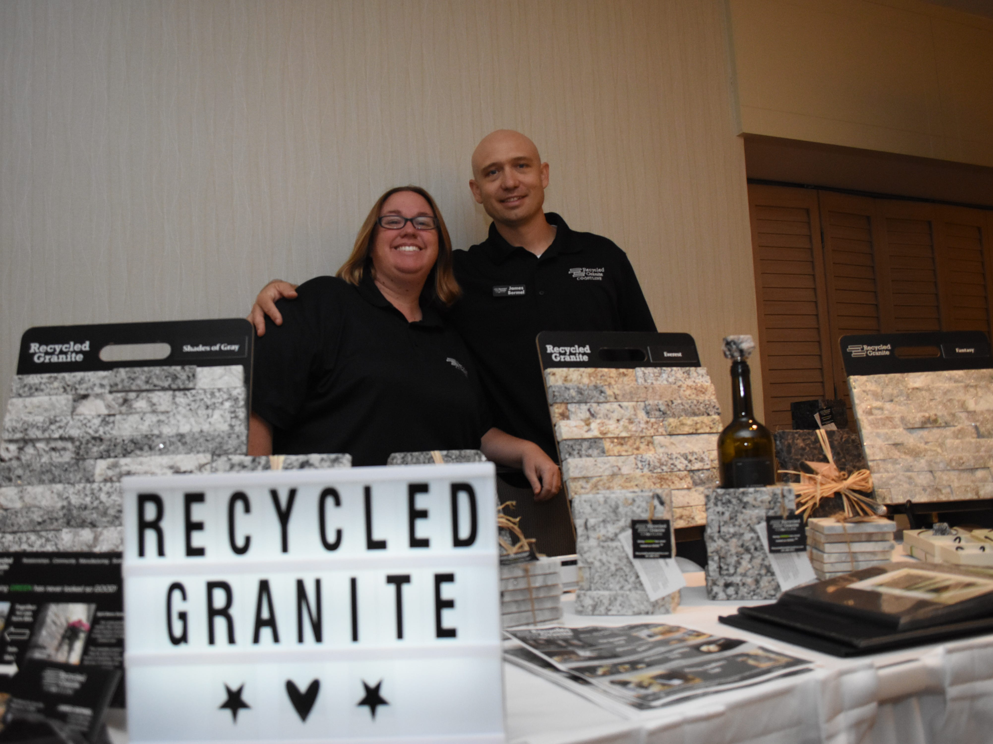 Pamela and James Bermel with Recycled Granite Coastline pose for a photo.