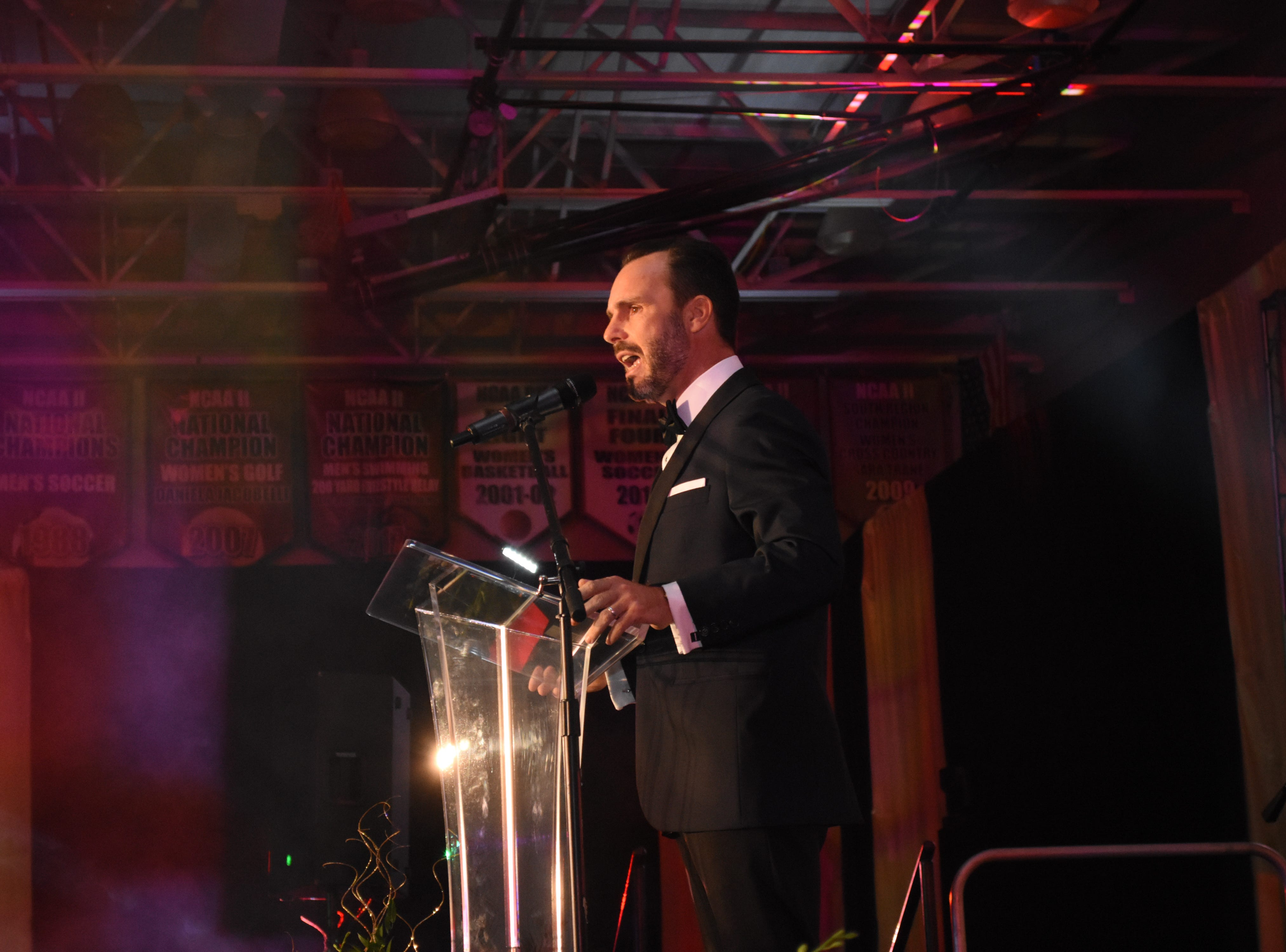 Florida Tech Executive Director of the Alumni Association and Master of Ceremonies Bino Campanini welcomes guests at Florida Tech's 60th Anniversary Homecoming Gala Oct. 13, 2018, at the Clemente Center.
