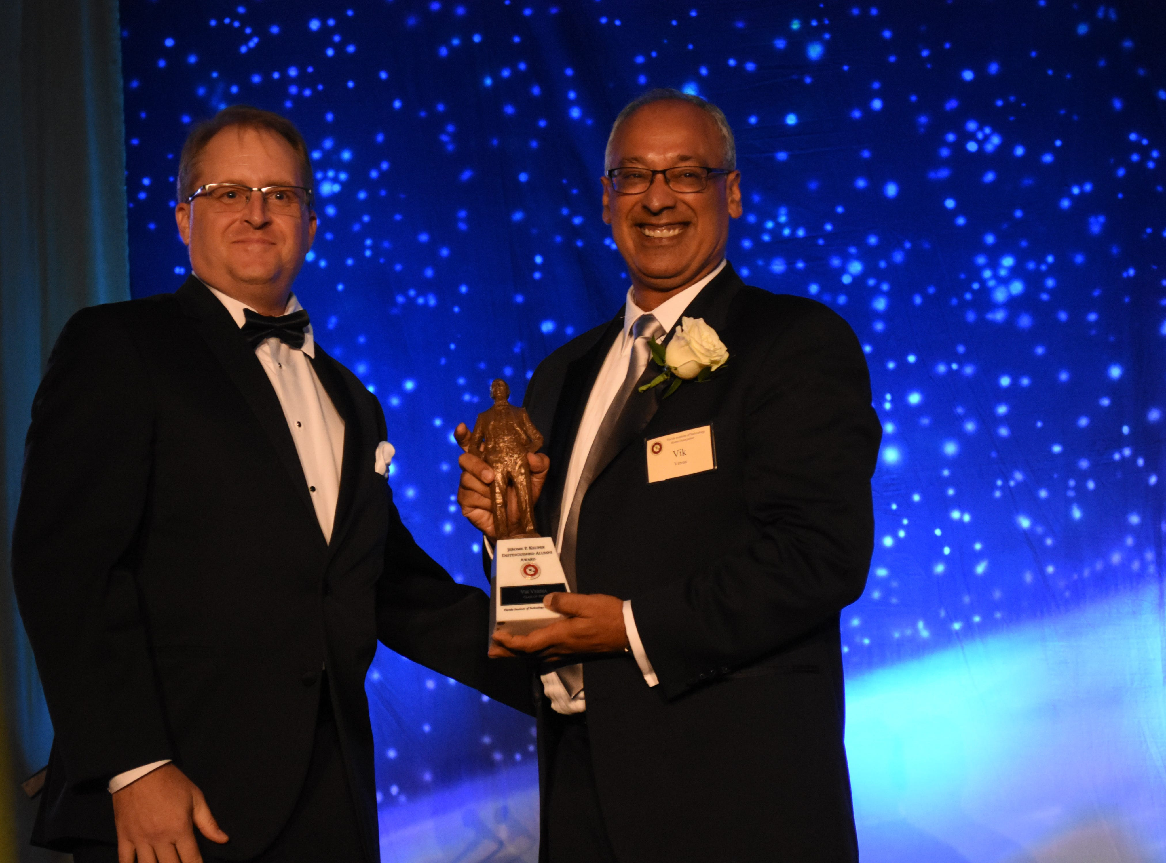 Vik Verna accepts the 2018 Jerome P. Keuper Distinguished Alumni Award at Florida Tech's 60th Anniversary Homecoming Gala Oct. 13, 2018, at the Clemente Center.