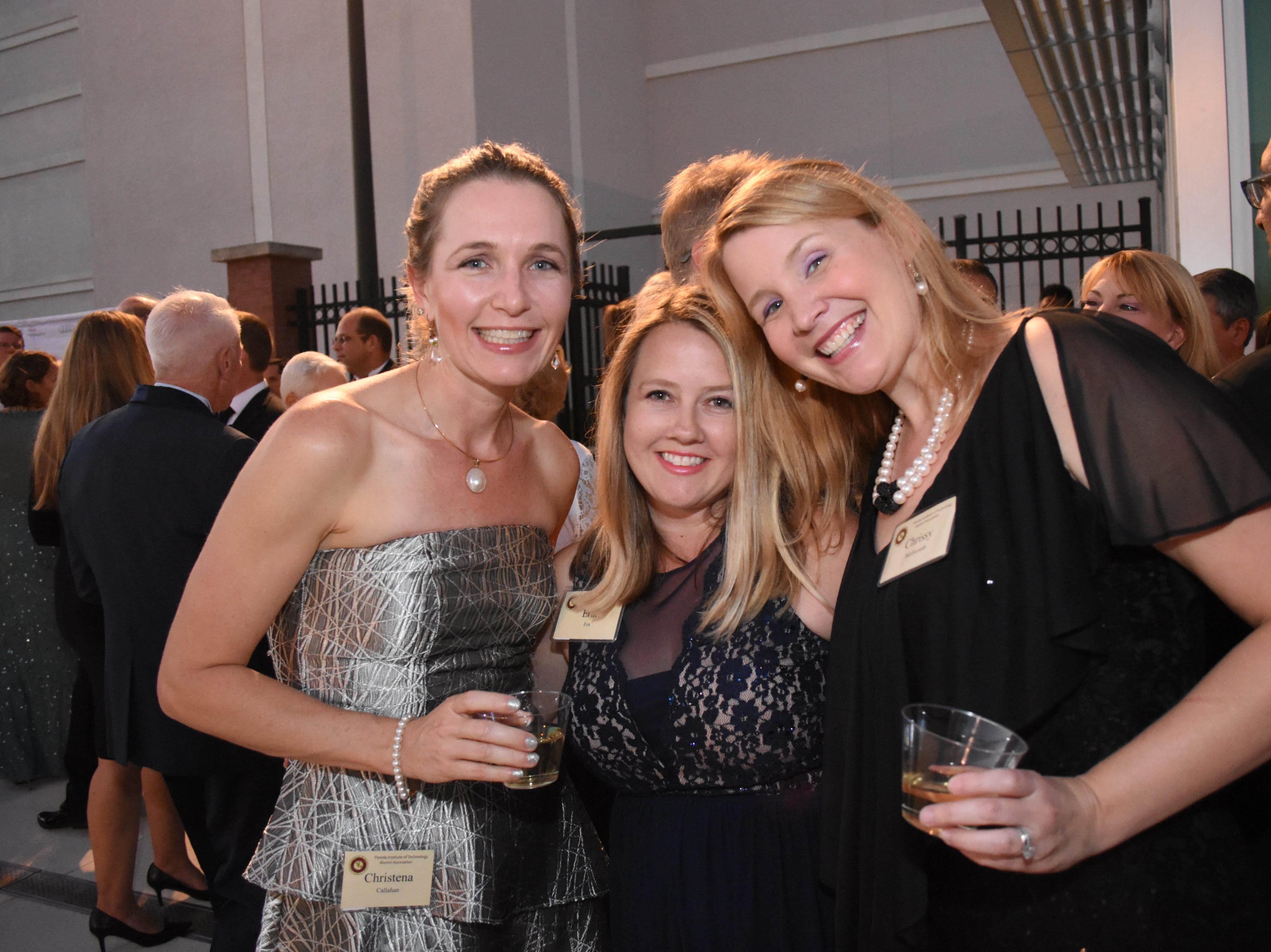 Christena Callahan, Erin Fox and Chrissy McIlwraith at Florida Tech's 60th Anniversary Homecoming Gala Oct. 13, 2018, at the Clemente Center.