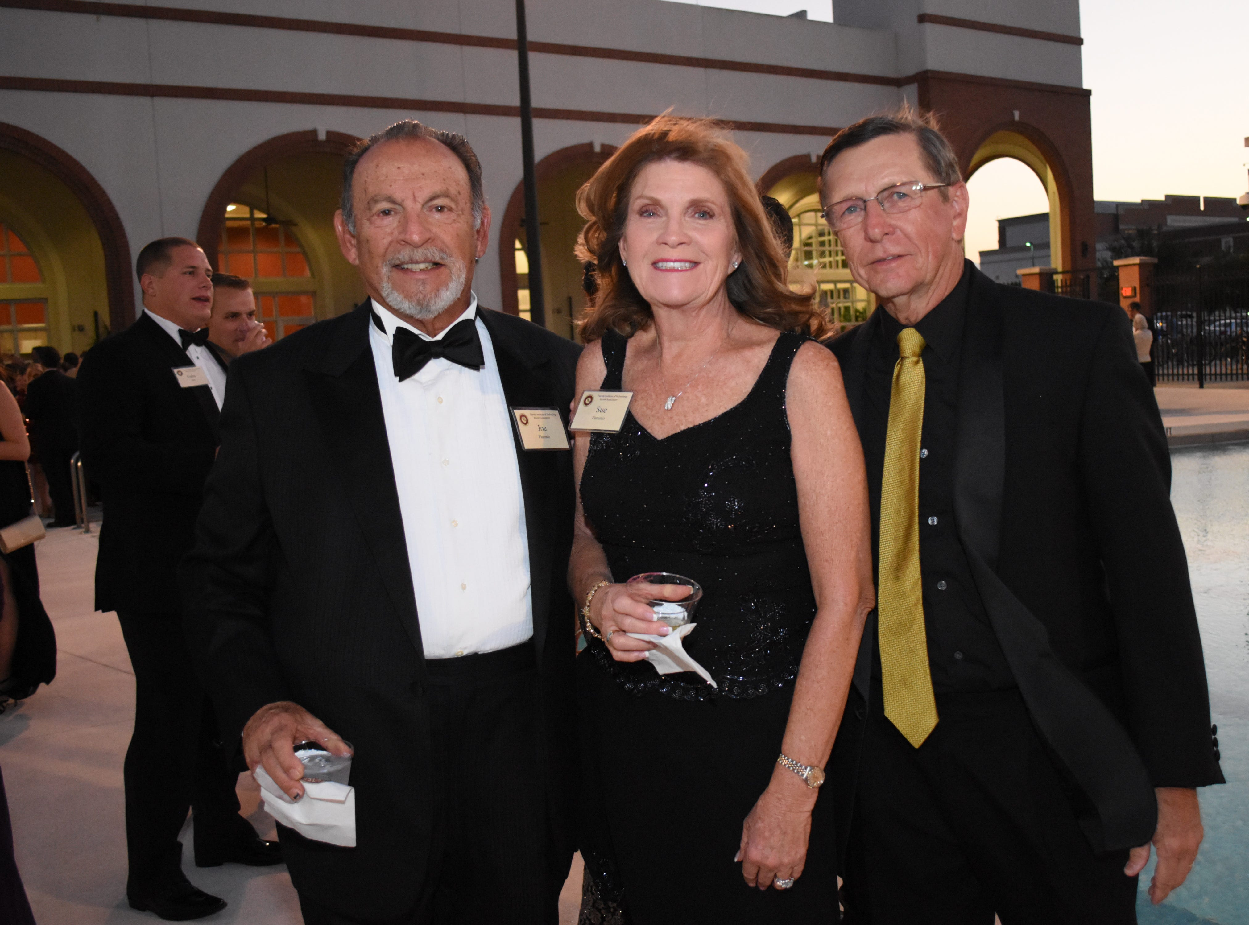 Joe and Sue Flammino poes for a photo with Florida Tech president Dr. T. Dwayne McCay at Florida Tech's 60th Anniversary Homecoming Gala Oct. 13, 2018, at the Clemente Center.