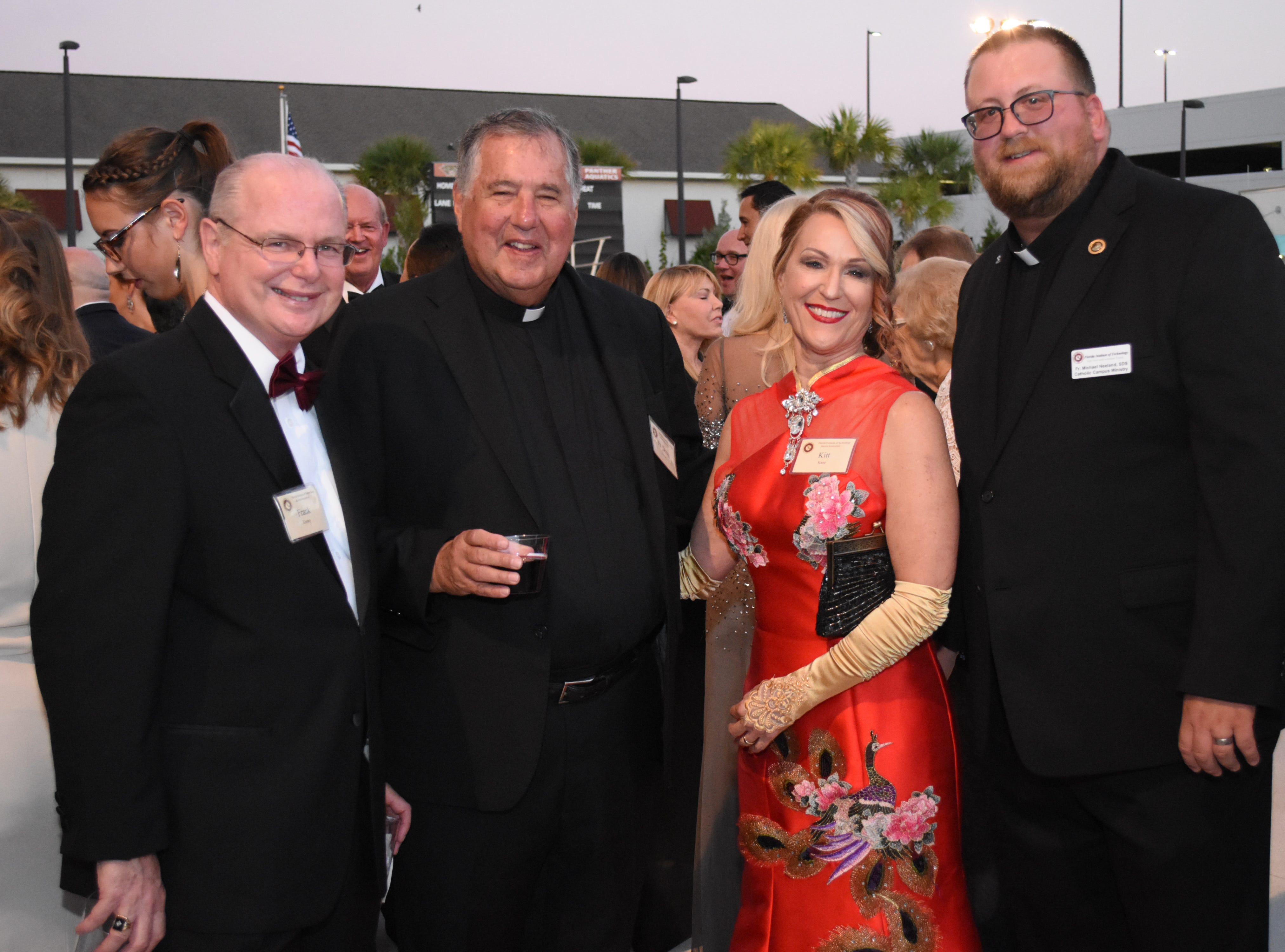 Frank Kinney, Fr. Doug Bailey, SDS, Kitt Kane and Fr. Michael Neeland, SDS, at Florida Tech's 60th Anniversary Homecoming Gala Oct. 13, 2018, at the Clemente Center.