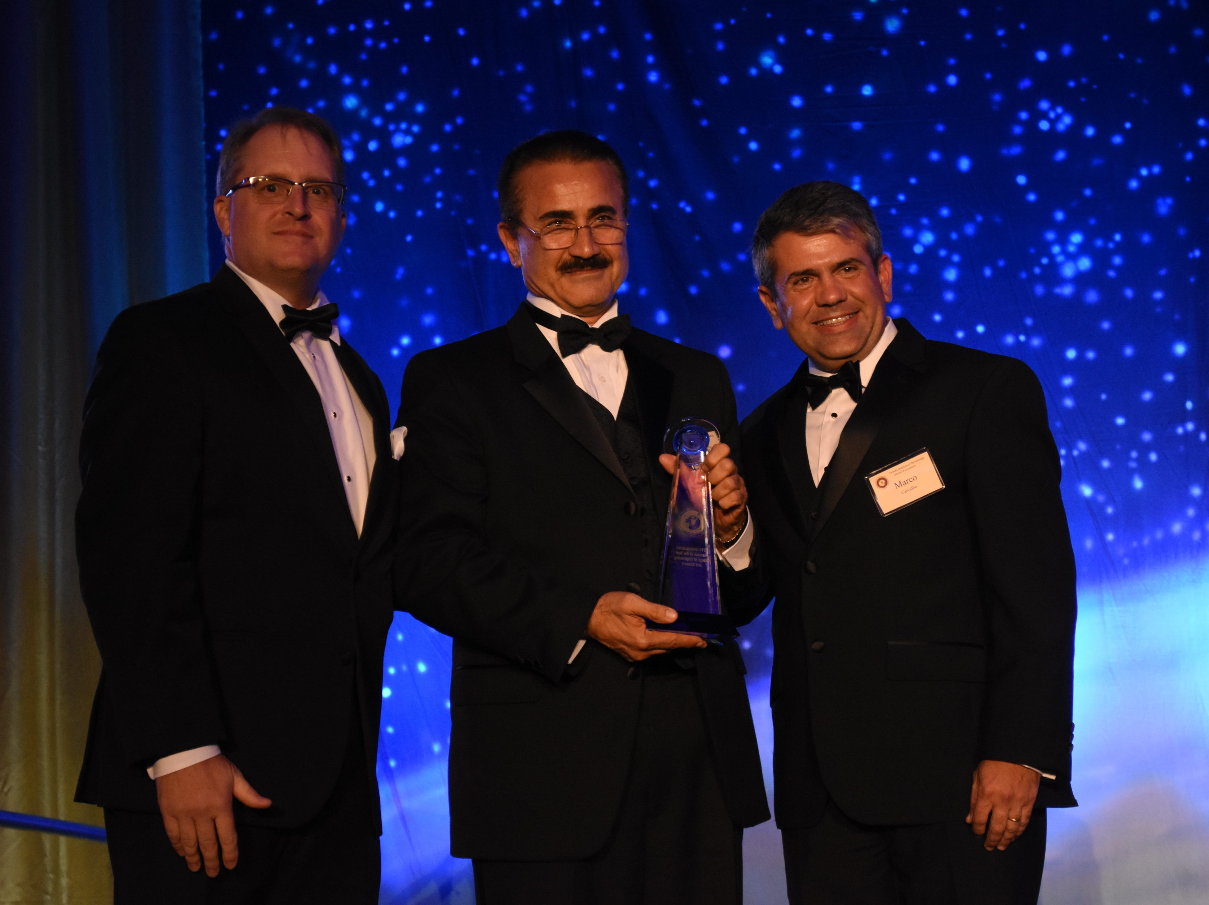 College of Engineering's Mojy Chian is presented the Outstanding Alumni award at Florida Tech's 60th Anniversary Homecoming Gala Oct. 13, 2018, at the Clemente Center.