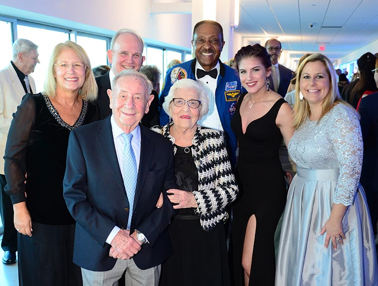 Rudolph and Toby Deligdish, Laura and William Boyle, Astronaut Winston Scott, Gabby Maggard, and Misty Wilson smile for the camera Saturday evening at Port Canaveral during the Fly Me to The Moon gala.