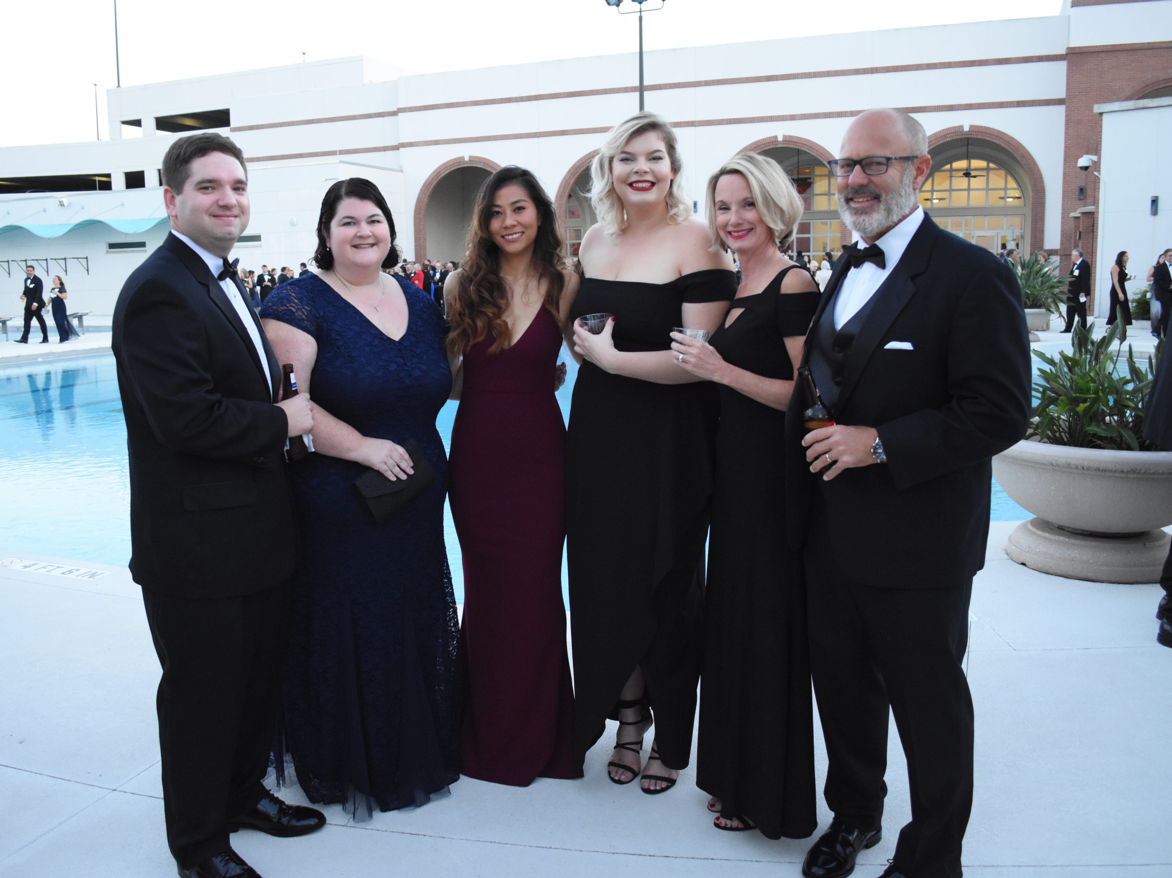 Nim Robinson, Emma Sandell, Erik Juliano, Sandy Petersen and Andrew Petersen pose for a photo at Florida Tech's 60th Anniversary Homecoming Gala Oct. 13, 2018, at the Clemente Center.