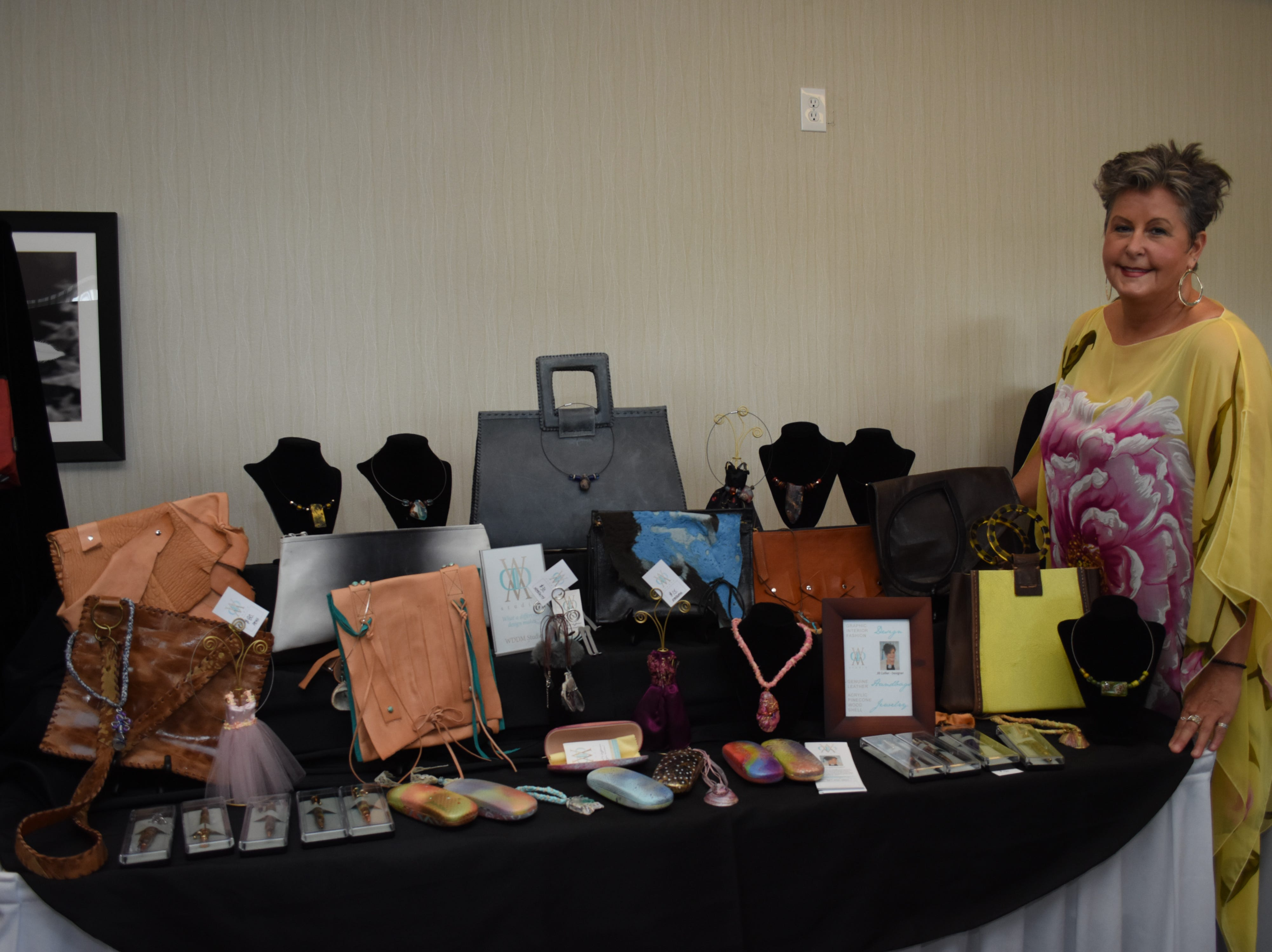 Jill Collier poses with her items for sale.