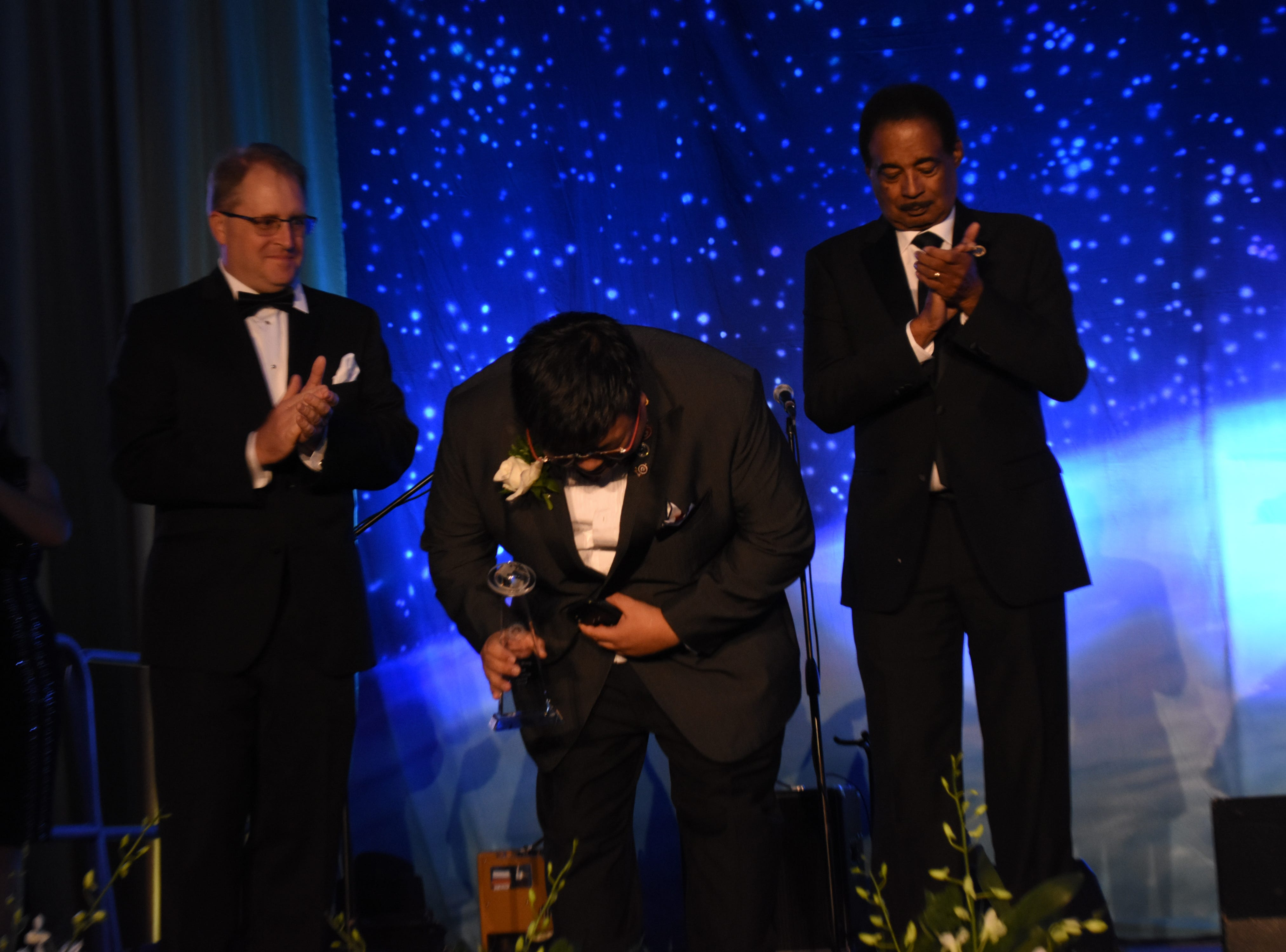 James Wong takes a bow after receiving his Outstanding Alumni from the College of Business at Florida Tech's 60th Anniversary Homecoming Gala Oct. 13, 2018, at the Clemente Center.