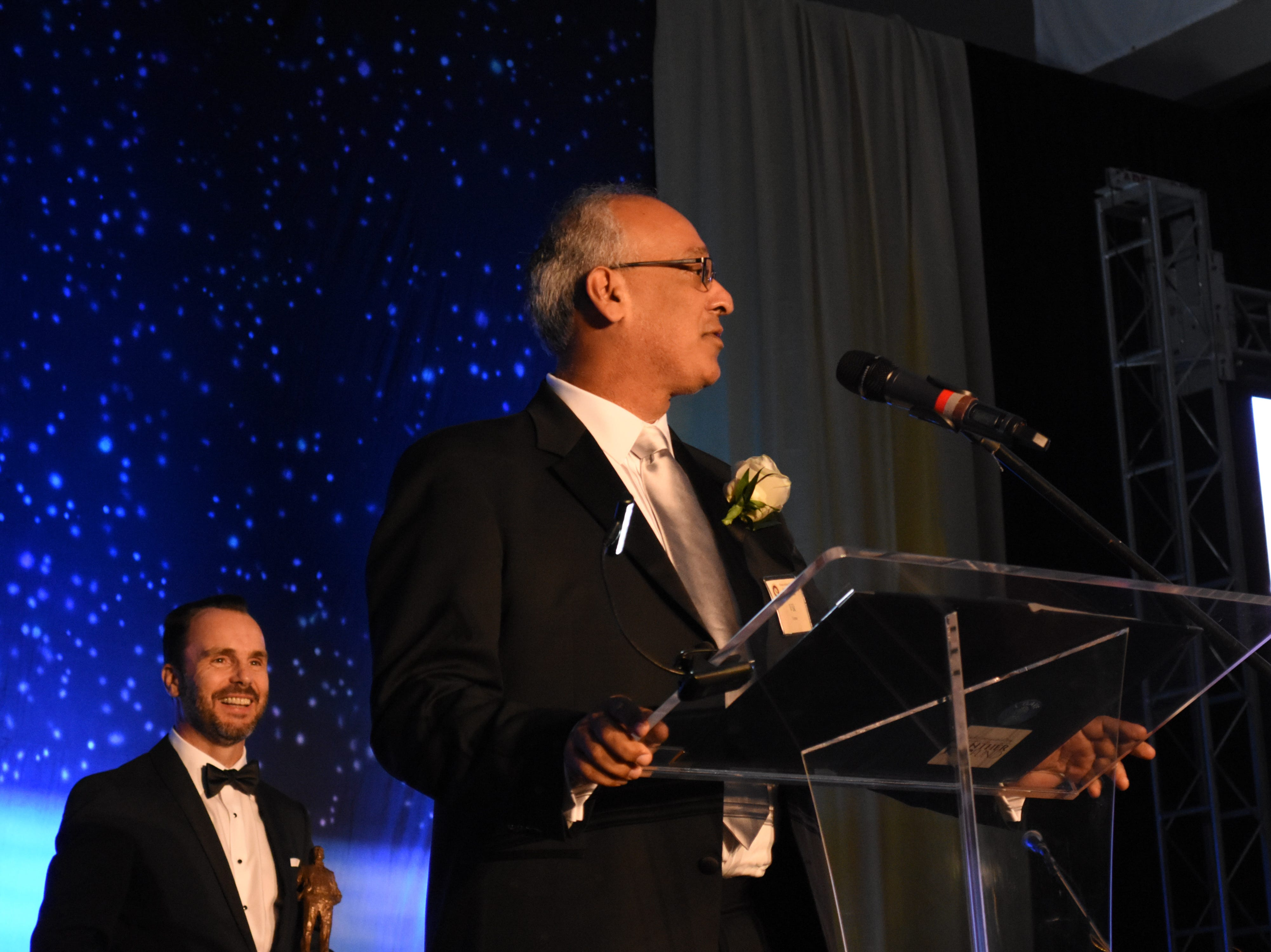 2018's Jerome P. Keuper Distinguished Alumni Award recipient Vik Verna speaks to the crowd at Florida Tech's 60th Anniversary Homecoming Gala Oct. 13, 2018, at the Clemente Center.