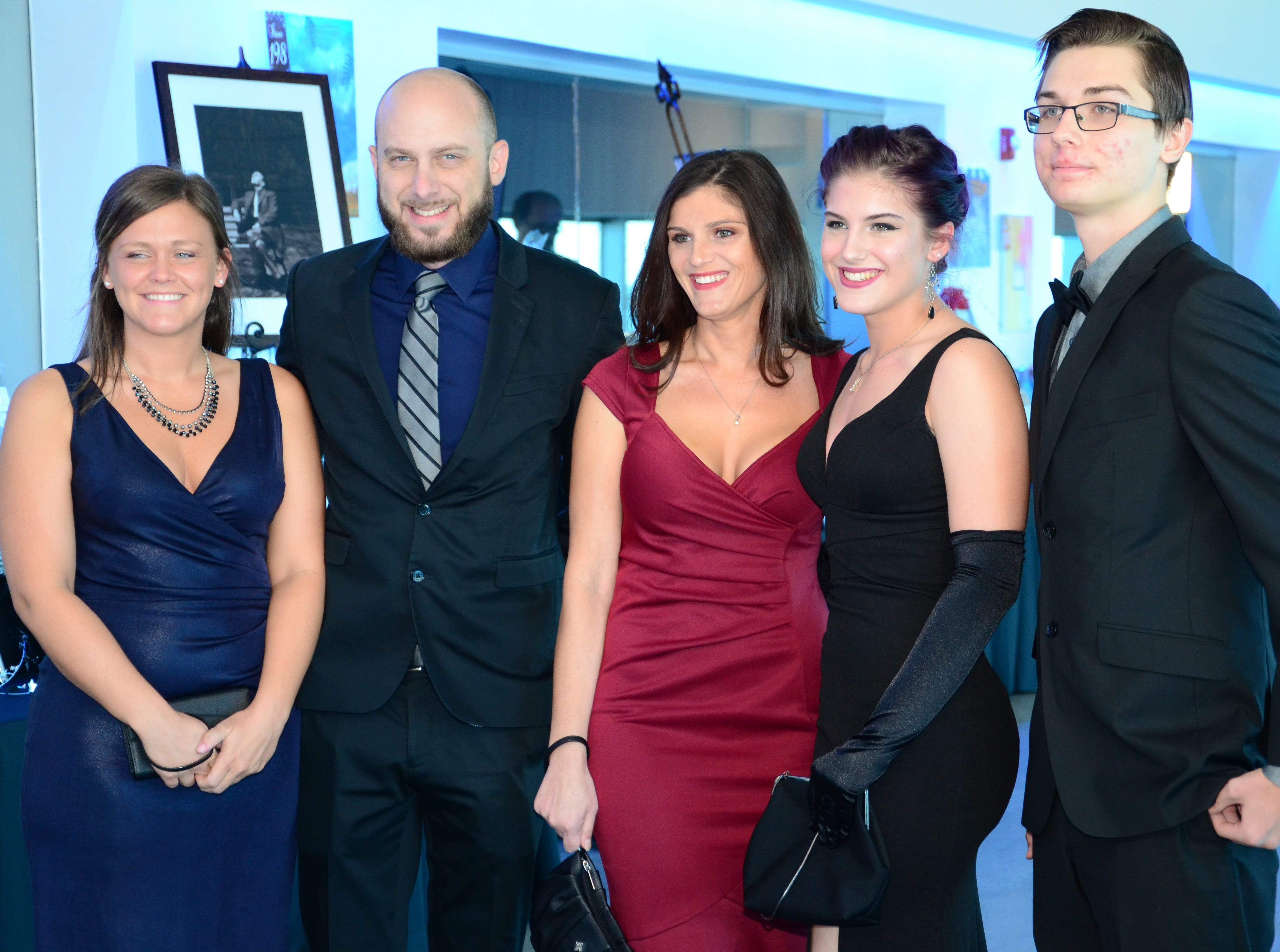 Samantha Hill, Dan Maggard, Danielle Lovett, Gabrielle Maggard and Mark Ovens arrive Saturday evening at Port Canaveral to be a part of the Fly Me to The Moon gala.