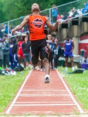 Woodrow Wilson's Diquese 'Dino' Young competes in the long jump during the Camden County Outdoor Track Championship in May 2017.