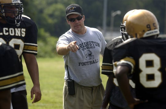 Burlington Township football coach Tom Maderia, in his first practice at the school in summer of 2003. The longtime leader spent 11 years at Holy Cross and is in his 16th season with the Falcons.