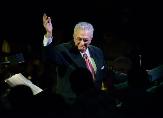 """A view that is familiar to any regular attendee of Cincinnati Ballet performances. Despite being tucked away in the orchestra pit, company music director Carmon DeLeone, who is celebrating his 50th season with the company during the 2018-2019 season, regularly makes a point of greeting the audience and acknowledging its applause. This photo was taken during one of the company's performances of """"Frisch's Present the Nutcracker"""" at the Aronoff Center in 2017."""