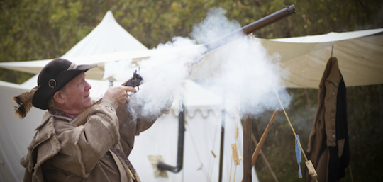 Lee Lynch demonstrates black powder firing at a previous Salt Festival.