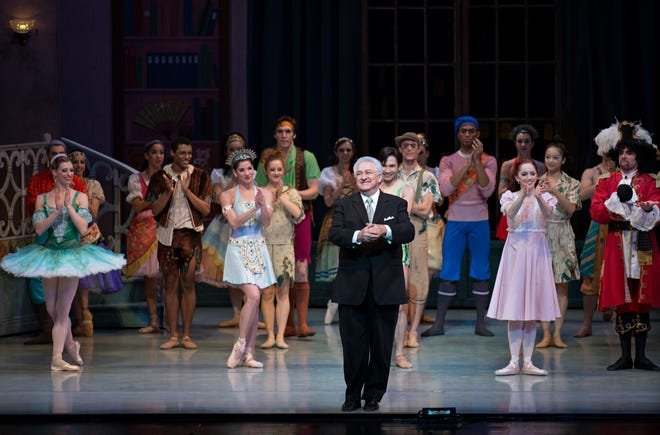 """Composer and music director Carmon DeLeone taking a bow following a 2014 Cincinnati Ballet performance of """"Peter Pan."""" DeLeone's score for the ballet was nominated for a Pulitzer Prize. The company performs the ballet at Music Hall Oct. 25-28."""