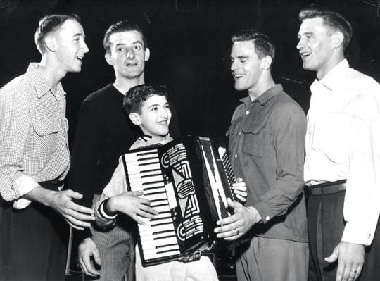 As a child, Cincinnati Ballet music director Carmon DeLeone was a skilled accordion player. Here, in a photo from the early 1950s, he is seen performing with a vocal quartet in a performance in Kent, Ohio.