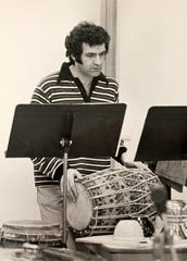 "Longtime Cincinnati Ballet music director Carmon DeLeone in a 1973 rehearsal for James Truitte's adaptation of Lester Horton's ""Face of Violence."" The work, with a score by DeLeone, became a calling card for the ambitious young company."