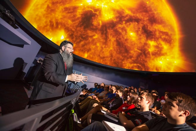 Students attend class in the new SciDome planetarium, a partnership with The Works: Ohio Center for History, Art and Technology.