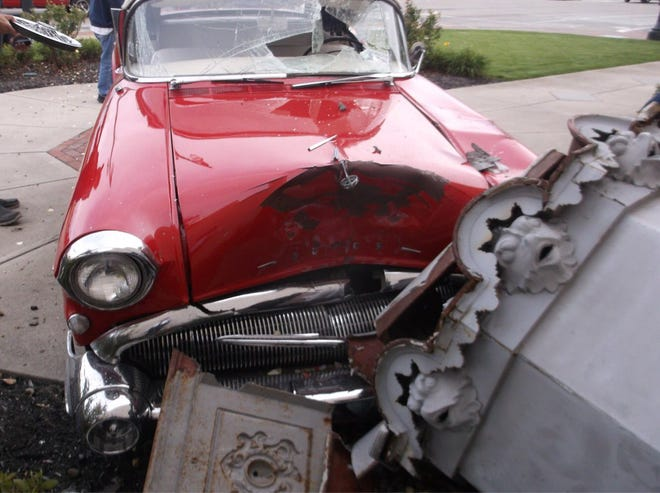 A car crash in Hamilton destroyed a vintage car and a historic statue