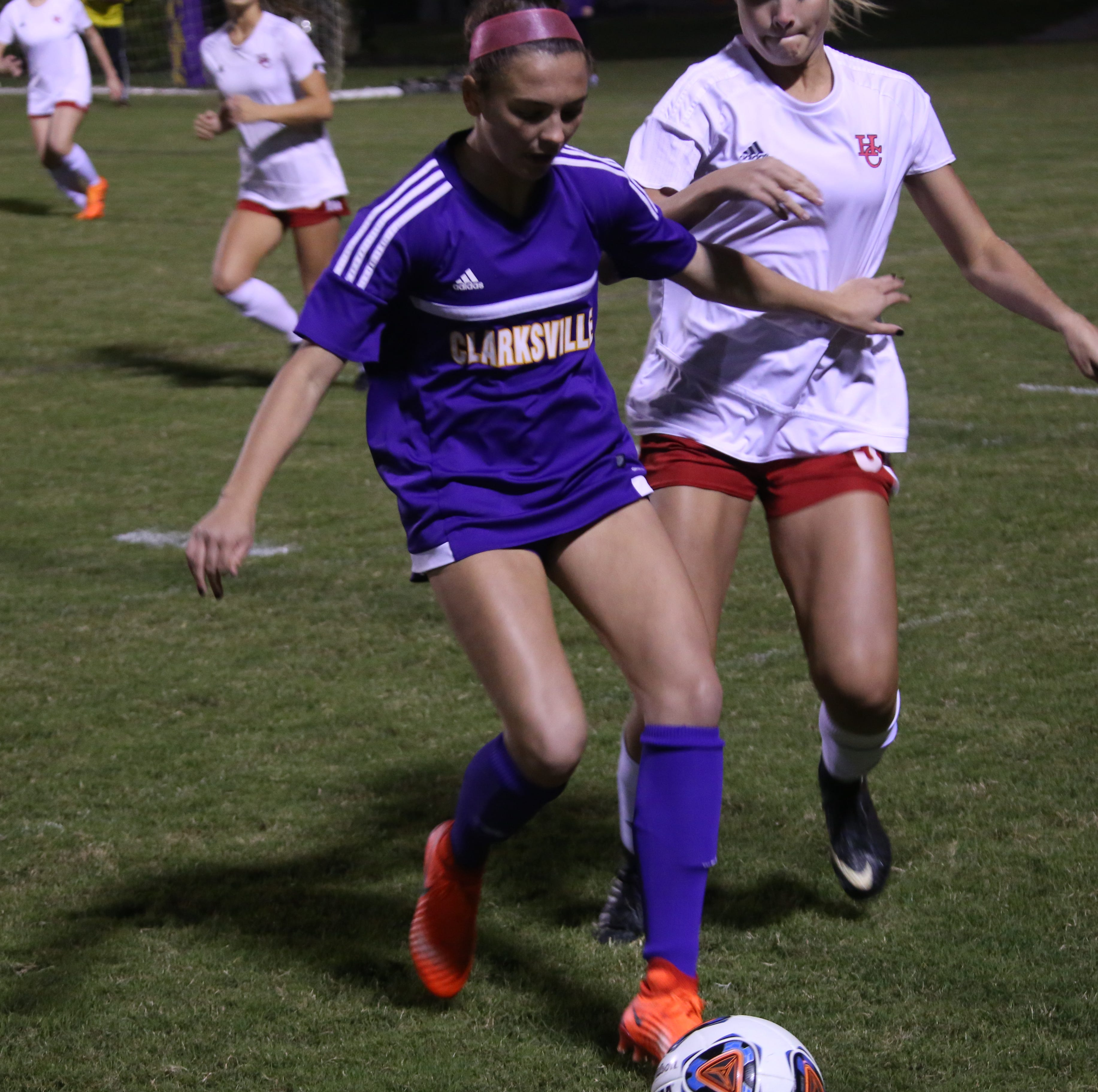 A Clarksville High player chases down the ball against Henry County during their Region 7-AAA championship game Wednesday night in which CHS beat the Lady Patriots, 8-2.
