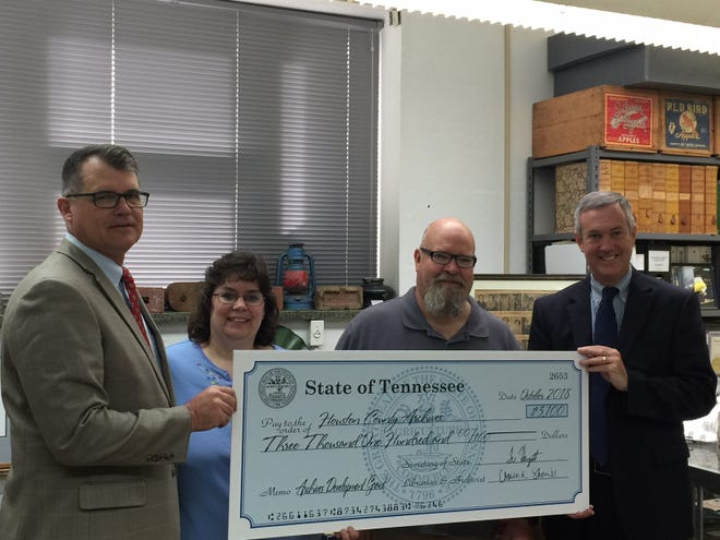 Tennessee Secretary of State Tre Hargett, right, recently visited Erin to deliver a $3,100 grant for Houston County Archives. The money will buy shelving and other materials to be used for expanding the Archives. From left is Dist. 74 state Rep. Jay Reedy, Houston County Archivist Melissa Barker, Houston County Mayor James Bridges and Hargett.