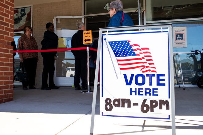 Community members wait in line to cast their votes at the Montgomery County Election Commission Thursday, Oct. 18, 2018, in Clarksville, Tenn.