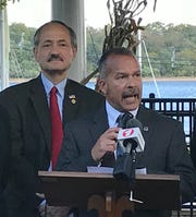 Councilman Joel Pabon stands at the microphone with Council President William Petrick behind him during a 2018 campaign event.