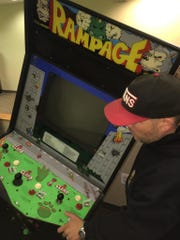 Colonial Soldier Arcade owner Jerold Colonna brings in arcade machines to get ready for the Nov. 3 opening.