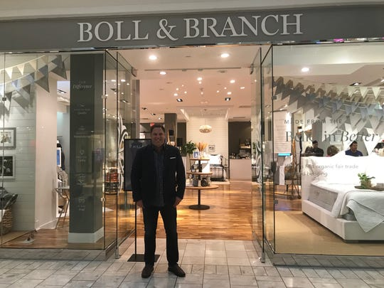 Scott Tannen, co-founder of Summit-based bedding retailer Boll & Branch, stands in front of its newly opened flagship store at The Mall at Short Hills. The brick-and-mortar location features the world's first organic, Fair Trade-certified brand's full collection of ethically made and sustainably sourced items.