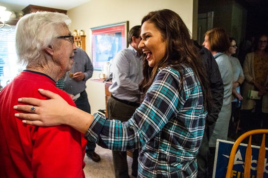 Abby Finkenauer, Democrat running against Rod Blum to serve as U.S. Representative for Iowa's 1st congressional district, talks with Democrats from Mitchell County on Wednesday, Oct. 17, 2018, in Osage.