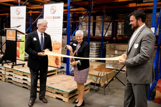 The Food Bank of Iowa recently launched a pilot program to increase food rescue in the Des Moines metro by partnering with Hy-Vee. In the photo, Des Moines Mayor Frank Cownie, Food Bank of Iowa President and CEO Michelle Book, and Food Bank of Iowa Board Chair Ross Dean celebrate major renovations finished last September.