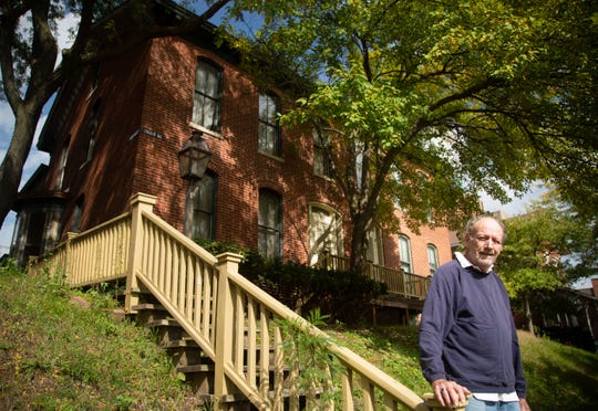 Kent Sissel stands in front of Alexander Clark's Muscatine home Tuesday, Oct. 9, 2018.