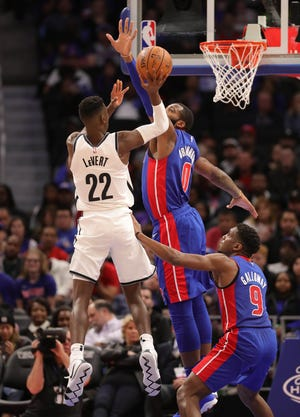 Andre Drummond (0) challenges the shot of Nets guard Caris LeVert during the Pistons' 103-100 win Oct. 17 at Little Caesars Arena.