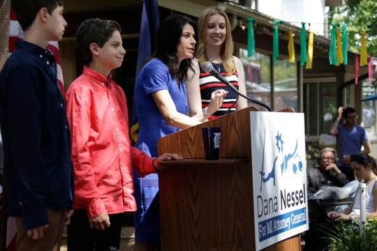 Zachary Nessel, 13, left, stands with his twin Alex as their mother attorney Dana Nessel announces her bid for Michigan Attorney General with her wife Alanna Maguire by her side in Ann Arbor on Tuesday Aug. 15, 2017.