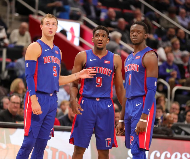 Pistons guards Luke Kennard (5), Langston Galloway (9) and Reggie Jackson (1) during a break during the Pistons' 103-100 win over the Nets on Wednesday at Little Caesars Arena.