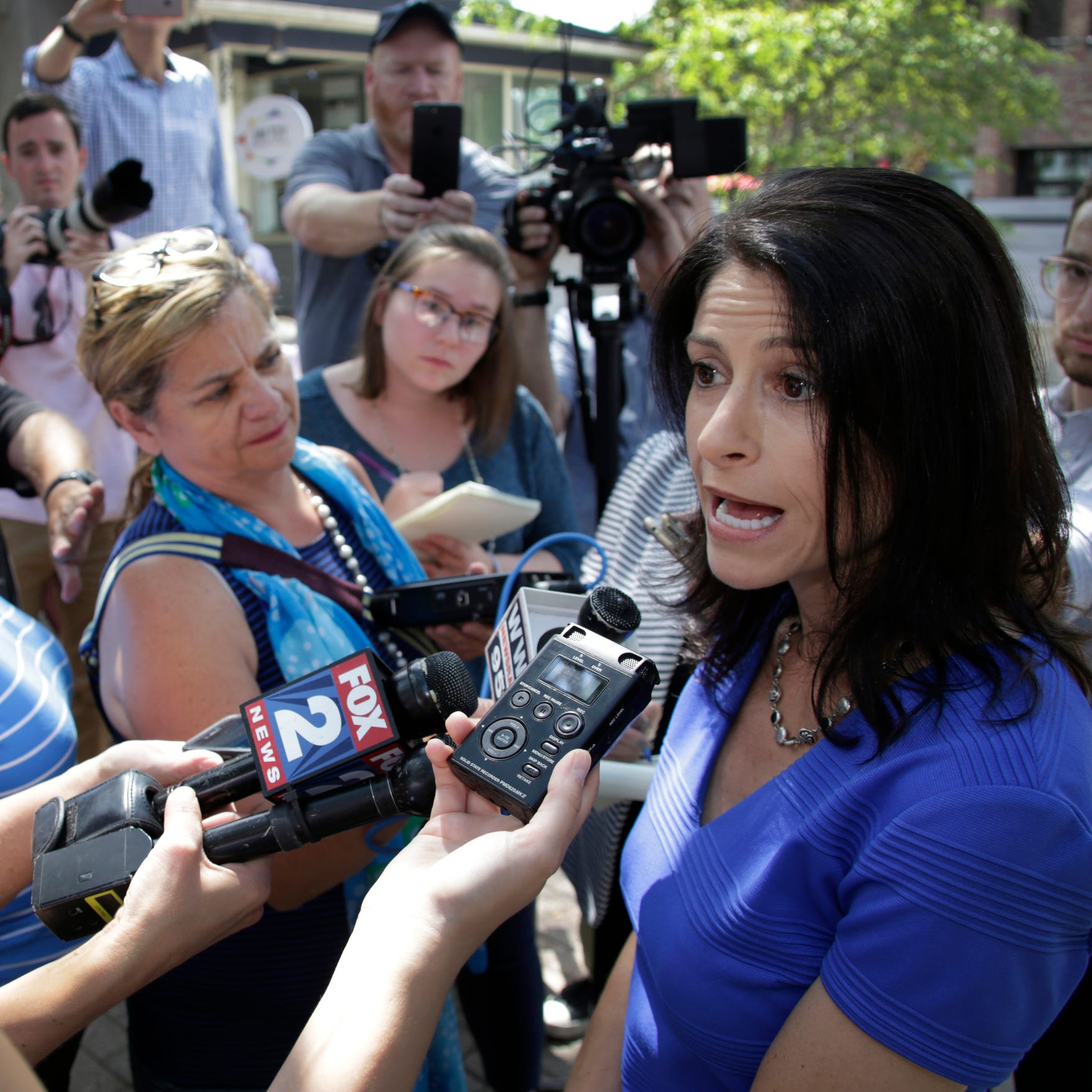 Attorney Dana Nessel is surrounded by media after she announces her bid for Michigan Attorney General in Ann Arbor Tuesday Aug. 15, 2017.