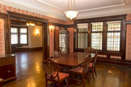 An elaborate coved ceiling dresses up the dining room as well as Craftsman style woodwork, done in mahogany. Light fixtures are all original, thought to be Steuben glass or alabaster
