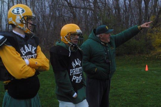Drew Stanton, left, Agim Shabaj, center, and head coach John Herrington, right, observe a play during Farmington Harrison High School's varsity football team's practice in Farmington Hills, MI, Monday, Nov. 19, 2001.