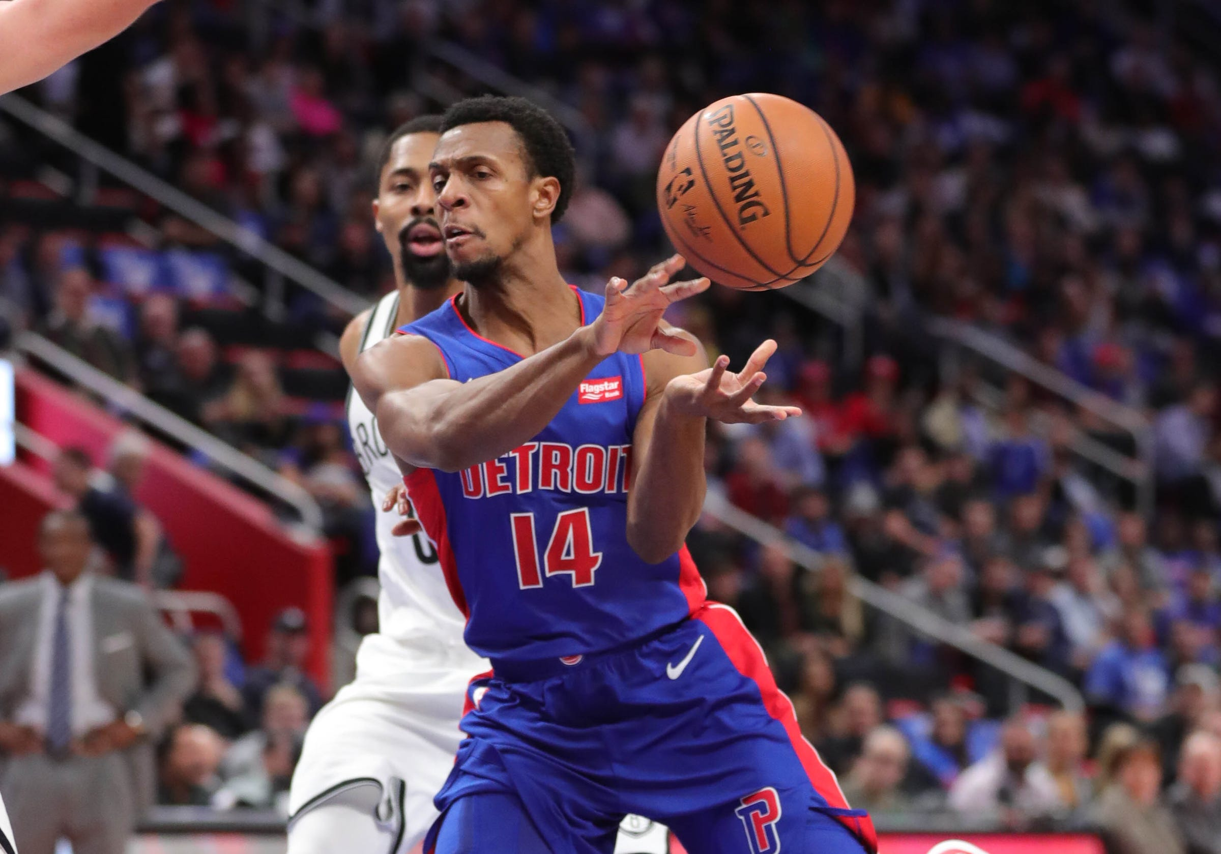 Pistons guard Ish Smith passes against Nets guard Spencer Dinwiddie during the third period of the Pistons' 103-100 win on Wednesday, Oct. 17, 2018, at Little Caesars Arena.