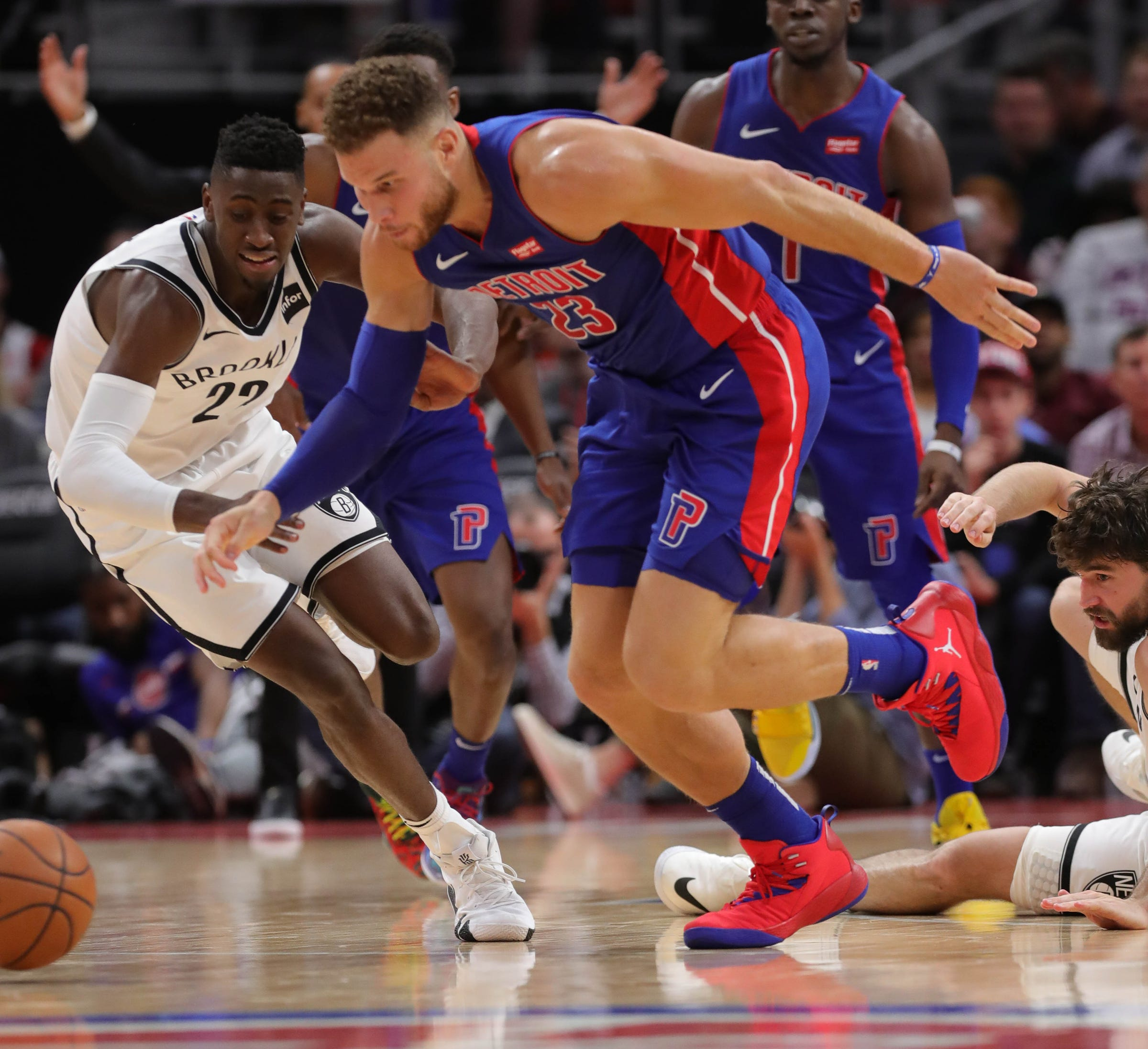 Pistons forward Blake Griffin goes for the ball against Nets guard Caris Levert during fourth period action Wednesday, October 17, 2018 at Little Caesars Arena in Detroit, Mich.